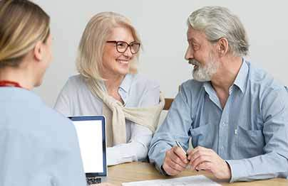 husband and wife consulting with sales rep